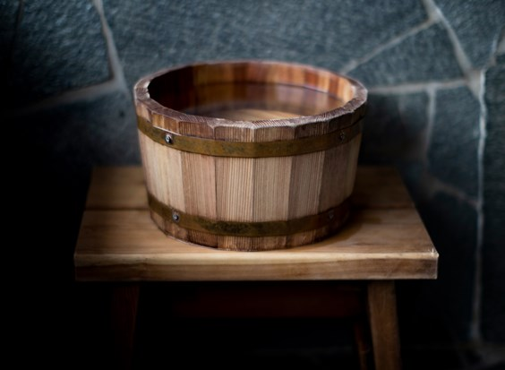 Wooden bucket with water
